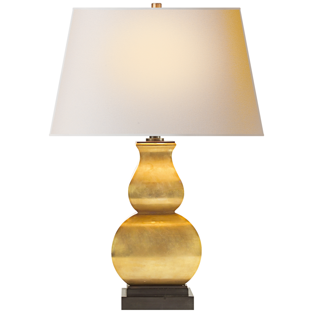 The Fang Gourd Table Lamp by Visual Comfort is a curved beauty. The natural paper shade exudes warmth and is the perfect addition to any bedroom, living room, or other area needing extra light  Designer: E. F. Chapman