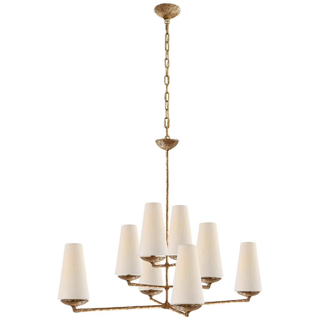 The Fontaine Large Offset Chandelier by Visual Comfort has a slim cross section at the bottom matched with offset layers of linen shades. This is a gorgeous piece to add to any dining room, living room, or other large area  Designer: AERIN