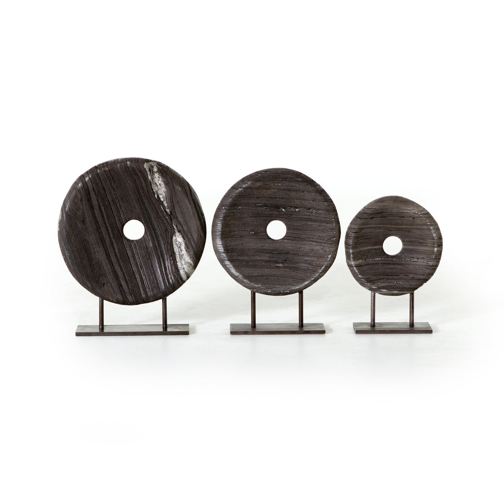 "These rounded, rough-hewn marble discs bring a modern feel to 19th century inspired mill wheels. The Linden Round Sculpture Set are a power trio and really elevate the space in your living room, entry way, or other area.   Comes in set of three.   Overall Dimensions: 15.00""w x 4.00""d x 18.50""h Colors: Natural Iron, Rough Black Marble Materials: Iron, Marble Weight: 70 lbs"