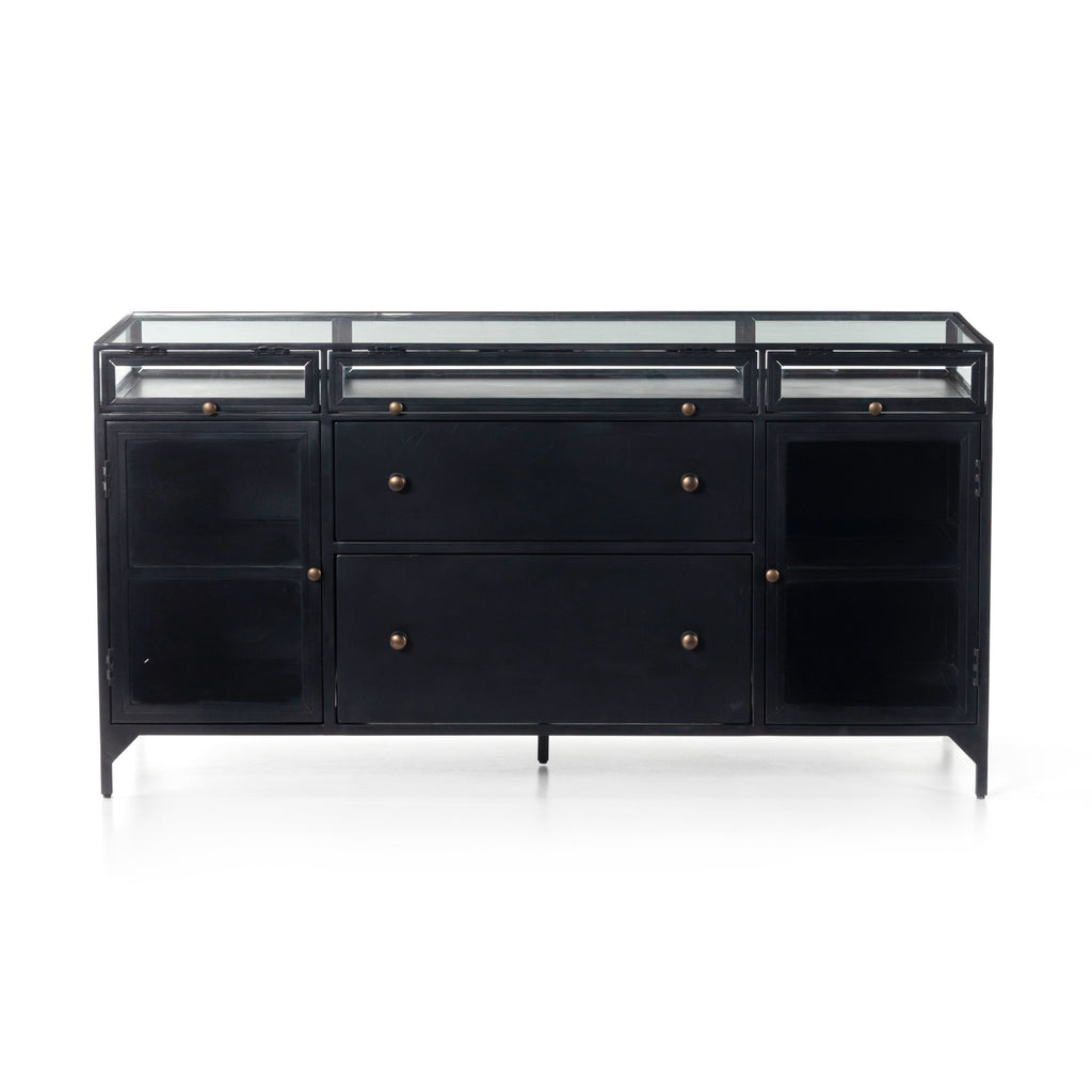 "This Shadow Box Modular Filing Credenza is finished in a gorgeous matte black. We love that the glass top allows you to showcase family heirlooms, while there are still drawers and shelves to allow for ample storage.   Overall Dimensions: 60.50""w x 23.00""d x 31.00""h Materials: Iron, Glass, Tempered Glass"
