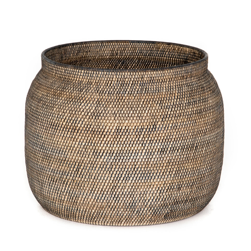 "This Ansel Contrast Black Basket is woven from natural Lombok and black rattan, bringing a gorgeous color and texture to the basket. A large, stylish basket to store your pet toys, blankets, or other items around the home.   Overall Dimensions: 24.00""w x 24.00""d x 18.50""h Colors: Natural Lombok Weave, Black Rattan Materials: Lombok, Rattan"