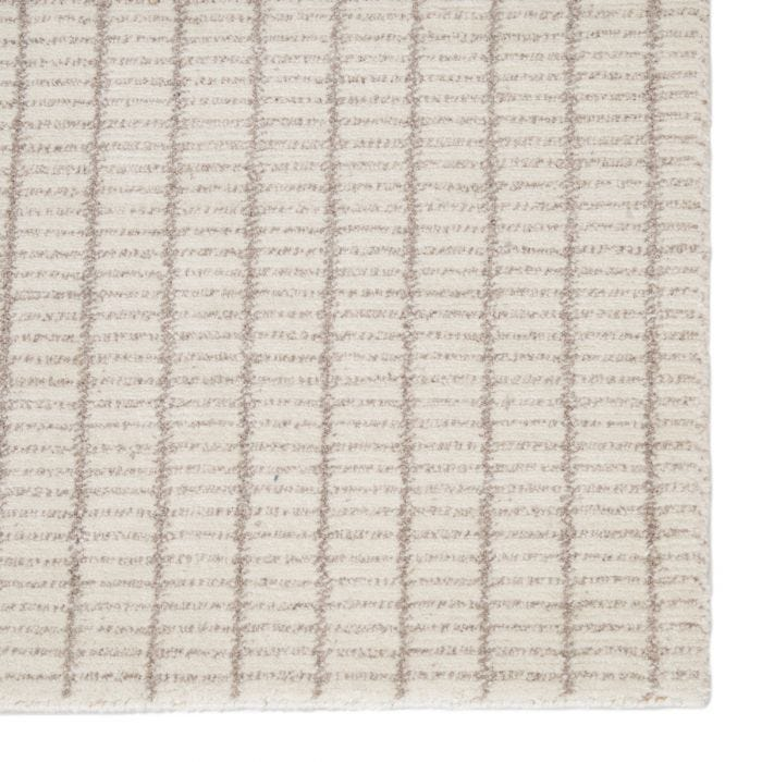 The Grove collection marries durability with textural details for an assortment of livable, stylish rugs. Hand-knotted of stain and fade-resistant polyester, the Stratton rug's chic plaid-like pattern features a light neutral cream and taupe colorway.  Hand-Knotted 100% Polyester GRV02 Grove Stratton Rug