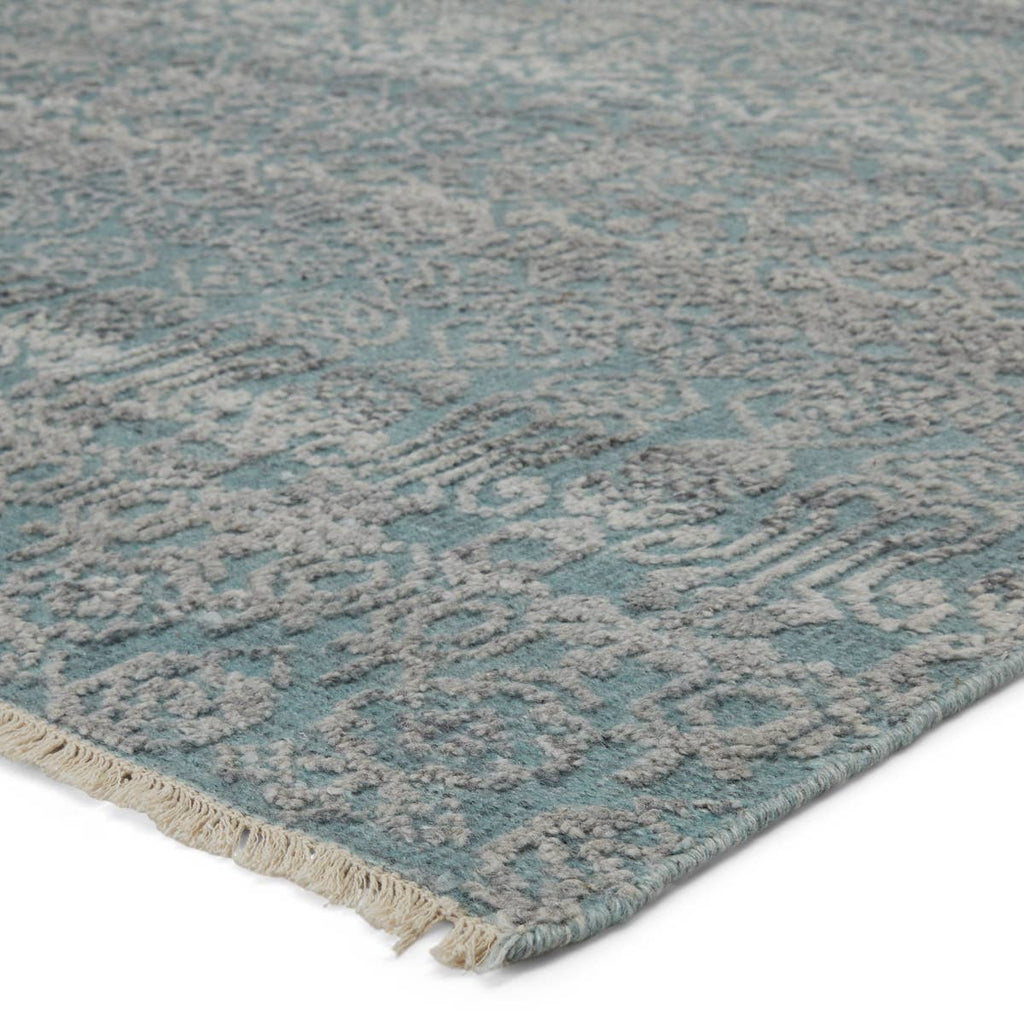 The hand-knotted Gaia Blue Kora Area Rug by Jaipur Living, or GAI01, features a blue and gray colorway for a soft and serene look. The space-dyed effect of the wool and viscose yarns lends a one-of-a-kind quality to every design. A gorgeous choice for your bedroom, living room, or other medium traffic areas.
