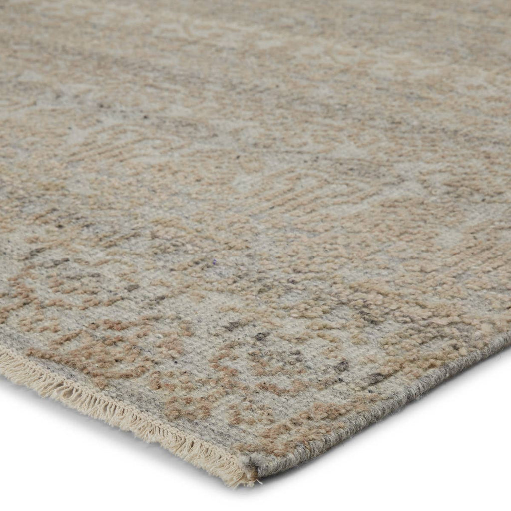 The Gaia Kora Area Rug by Jaipur Living, or GAI03, is crafted with a high-low carved texture. The hand-knotted Kora rug features a neutral gray, ivory, and warm beige colorway for a soft, serene look. A gorgeous choice for your bedroom, living room, or other medium traffic areas.
