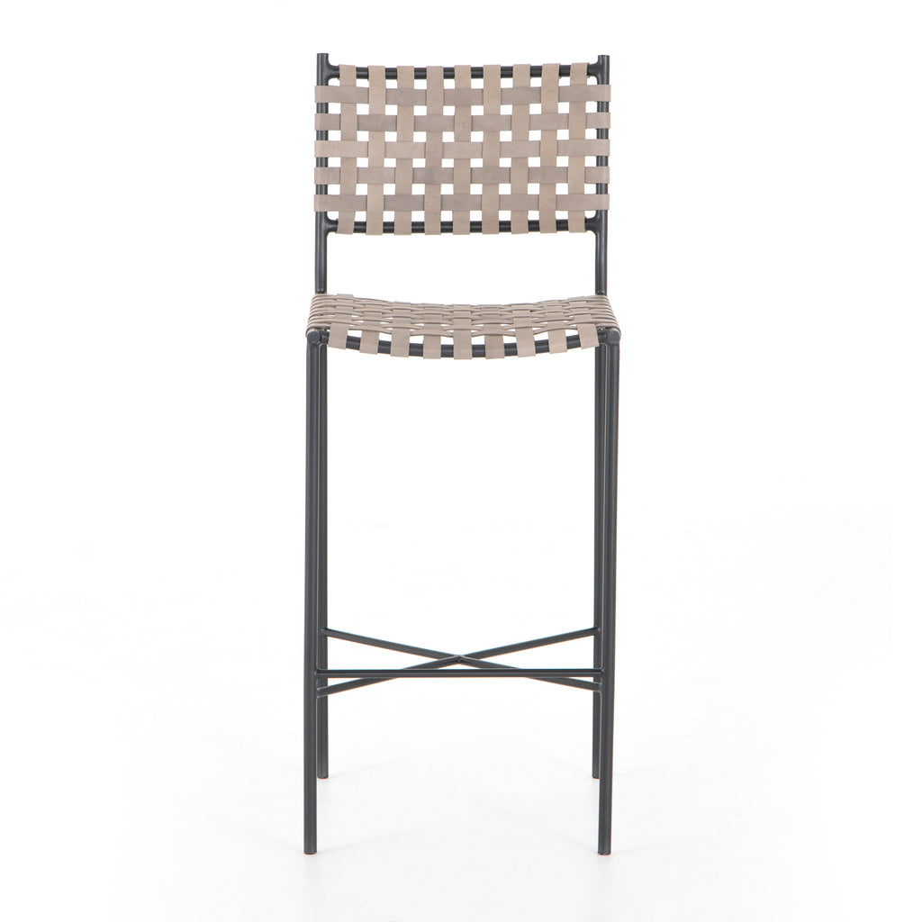 We love the textured look of the Garza Smoke Grey Bar + Counter Stool. The slim, black finished iron frame brings a modern farmhouse look to any kitchen or dining area.