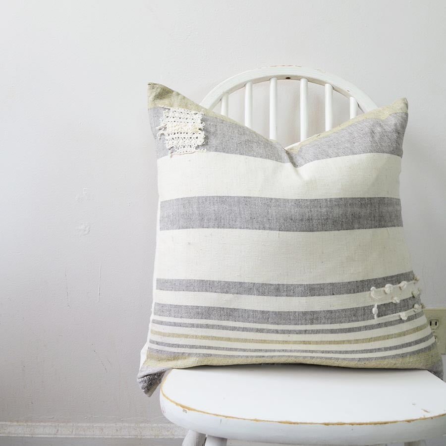 This organic cotton pillow in light grey and yellow colors adds great style to your room. The fabric is made from organic cotton that is hand spun and woven by artisan weavers on the handloom.