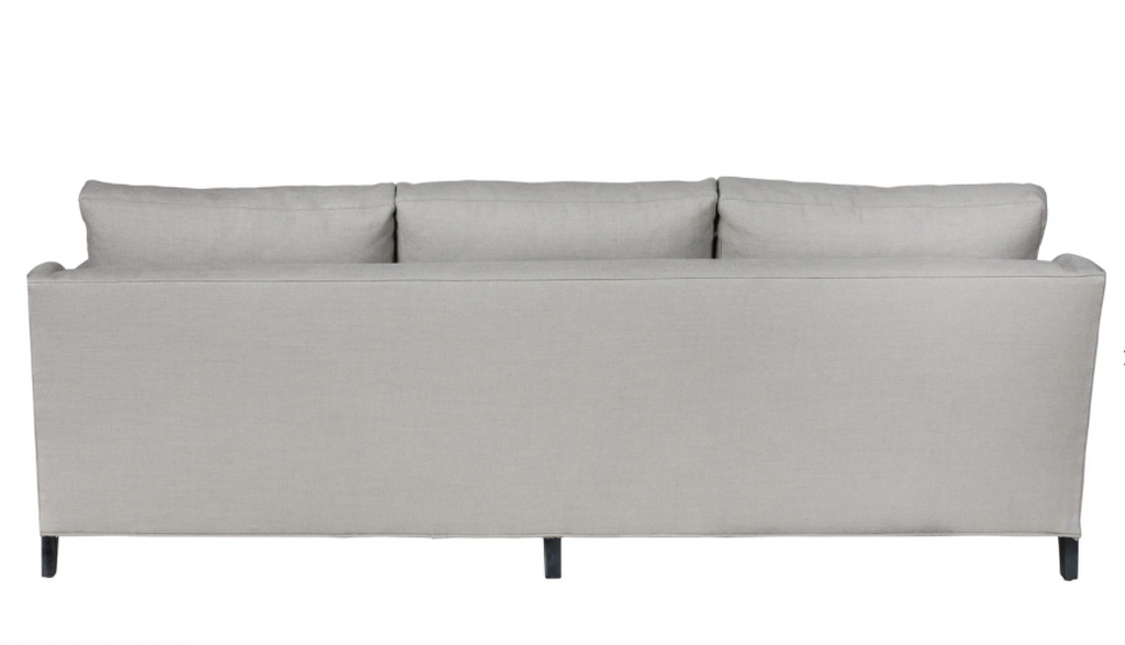 "A chic, yet simple design, the Gunner Upholstered Sofa by Cisco Brothers boasts a streamlined frame supported by tapered legs. This sofa is beautifully detailed, with piping on the body and top stitch on cushions. It has a traditional yet sleek look, ideal for entertaining. Photographed in Brevard Pewter.   Overall: 84""w x 36""d x 25""h"