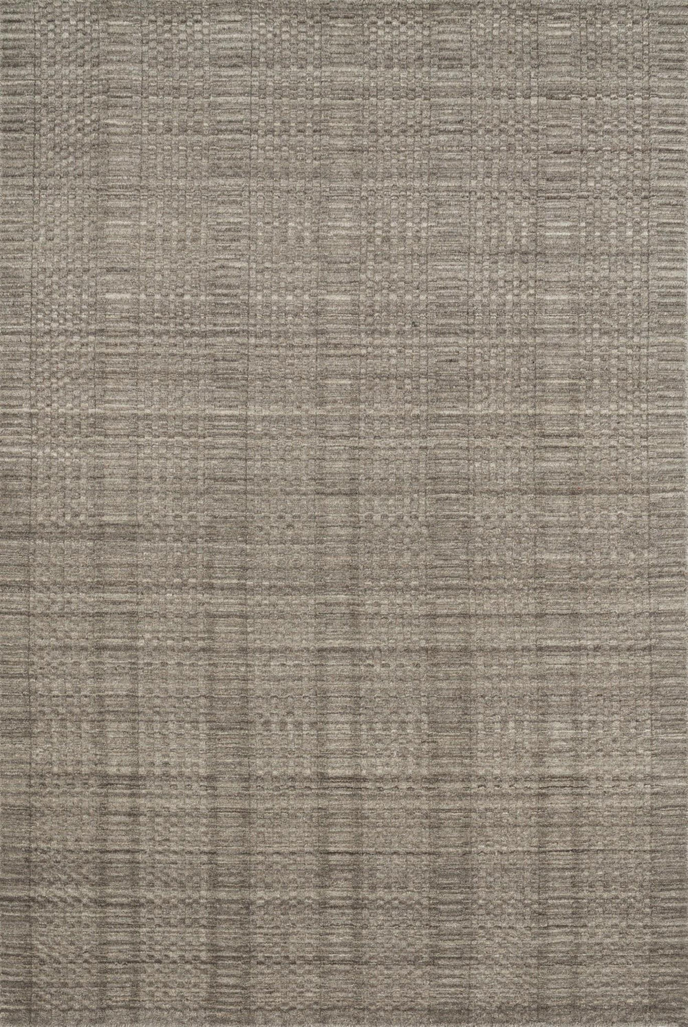 Natural beauty is expressed in an understated fashion with the Hadley Collection, an eco-friendly collection of 100% undyed wool. Loom knotted in India, Hadley features an intriguing cut pile and loop combination which adds distinctive texture to these handsome and durable designs. Also, the muted colors fit easily with a variety of interior styles while still earning notice with raw elegance.  Hand Loomed 100% Wool India HD-03 Stone