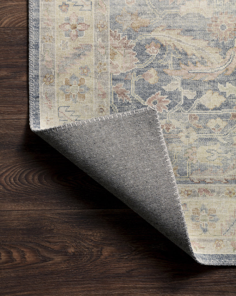 Featuring soft motifs in a carefully curated color palate, the Hathaway Collection captures the essence of one-of-a-kind rugs at an attractive price. Power-loomed of polyester, each design is the perfect blend of vintage and modern for today's home.  Power Loomed 100% Polyester HTH-02 Denim / Multi