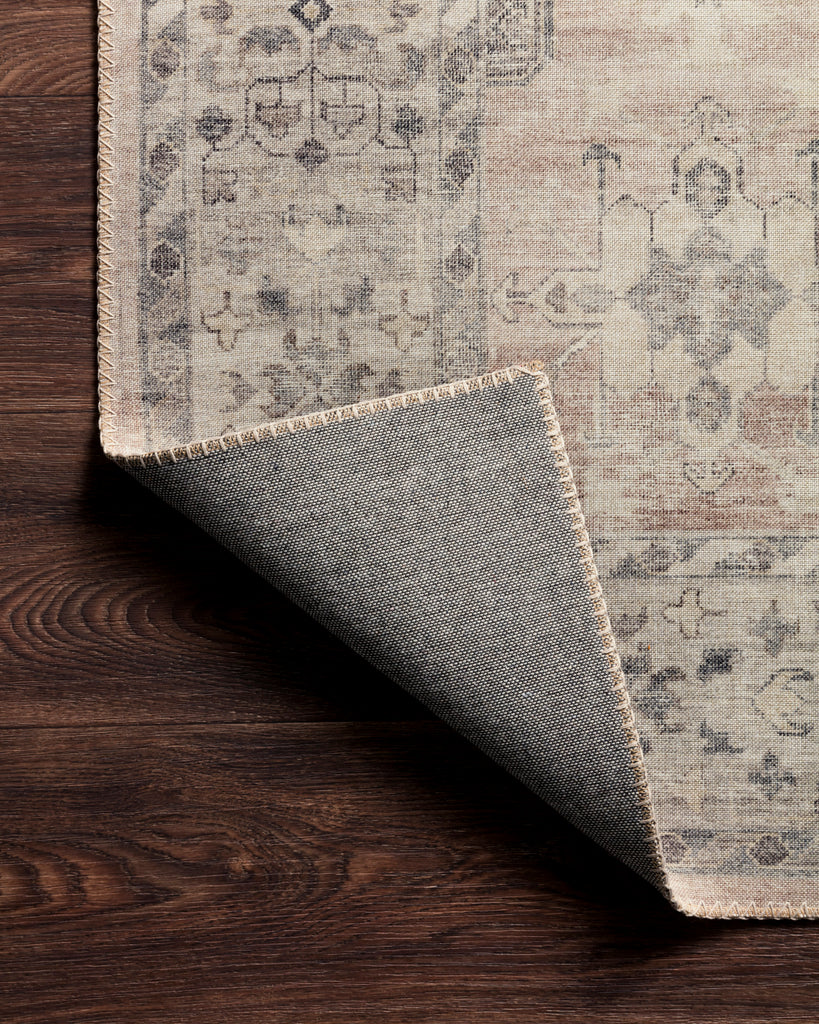 Featuring soft motifs in a carefully curated color palate of ivory, red, grey, and hints of blue, the Hathaway Java / Multi area rug captures the essence of one-of-a-kind vintage or antique area rug. This rug is ideal for high traffic areas such as living rooms, dining rooms, kitchens, hallways, and entryways.