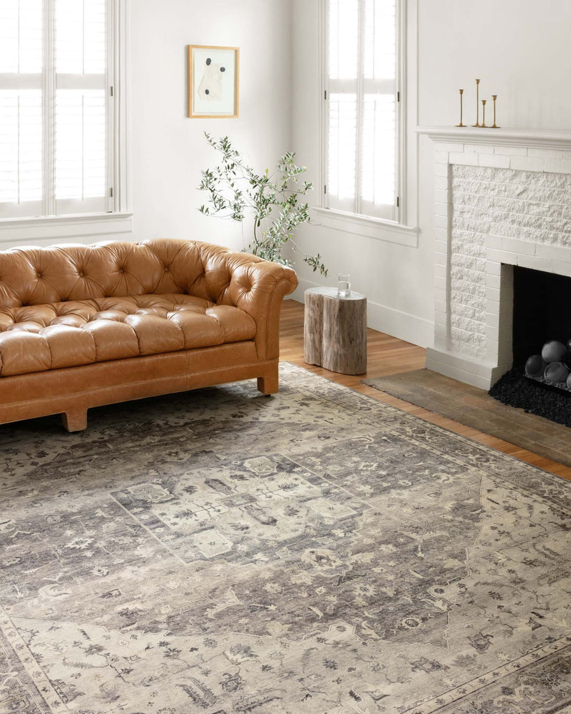 Featuring soft motifs in a carefully curated color palate of grey, black, ivory and hints of blue, the Hathaway Steel / Ivory area rug captures the essence of one-of-a-kind vintage or antique area rug. This rug is ideal for high traffic areas such as living rooms, dining rooms, kitchens, hallways, and entryways.