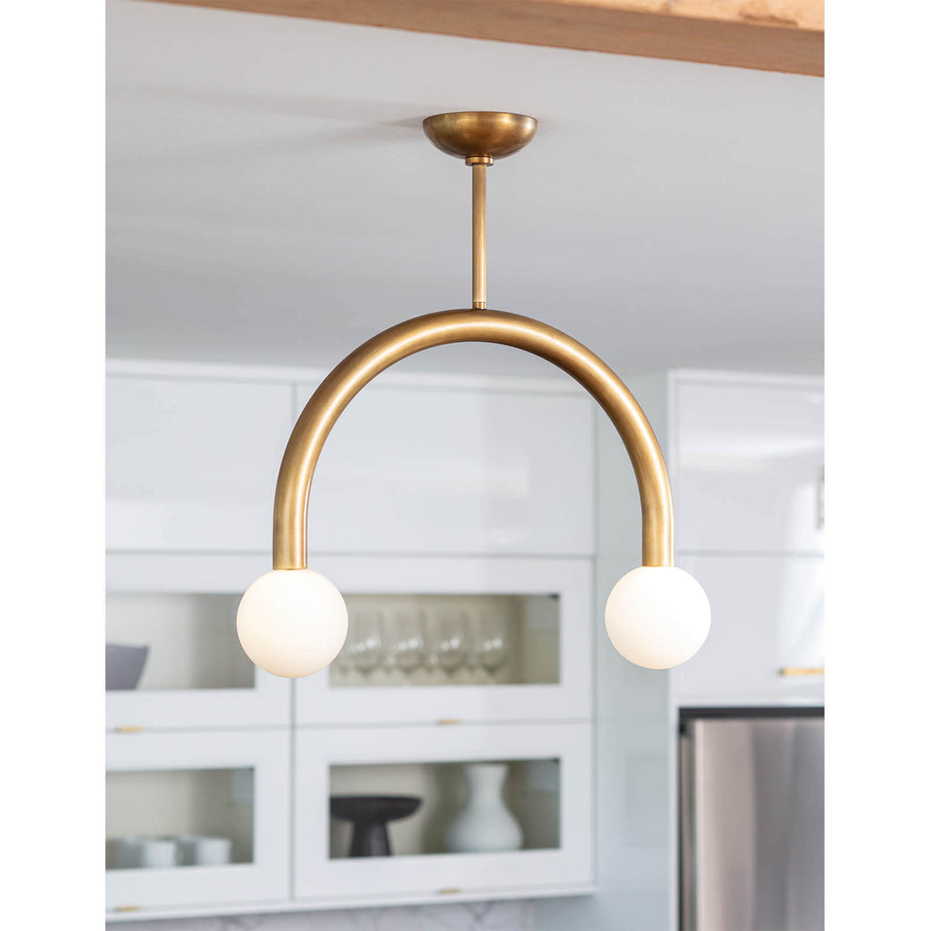 We love the unique, symmetrical shape of this Happy Pendant Small by Regina Andrews. This adds a modern yet playful lighting to any kitchen, living room, or other area needing extra lighting.