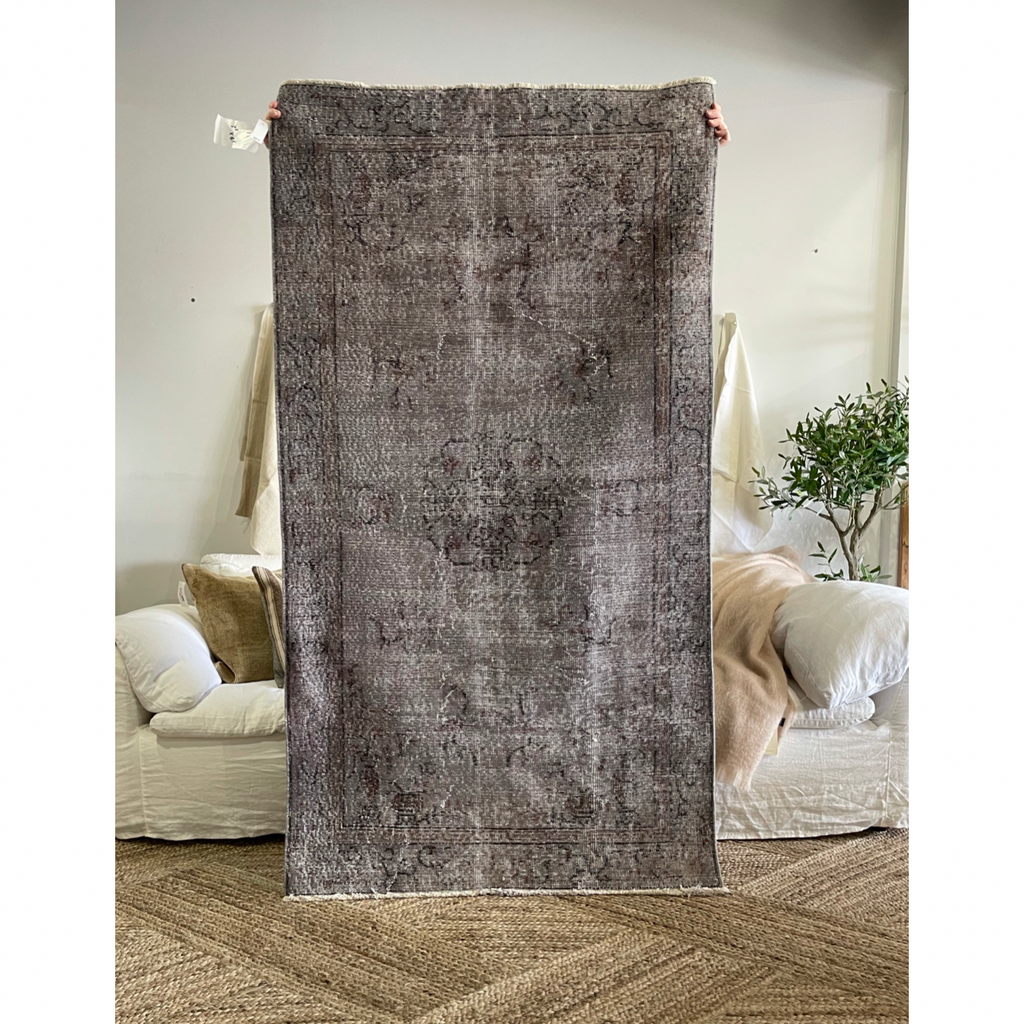 "The Hazel Vintage Turkish Area Rug has beautiful shades of purple and taupe with a subtle medallion design. This hand knotted vintage area rug is easy to care and maintain and will have very little shedding. The rug is a perfect fit for an entryway, bathroom, back door, laundry room, bedroom, or any other place!  Hand Knotted 100% Wool 3'8"" x 6'8"""