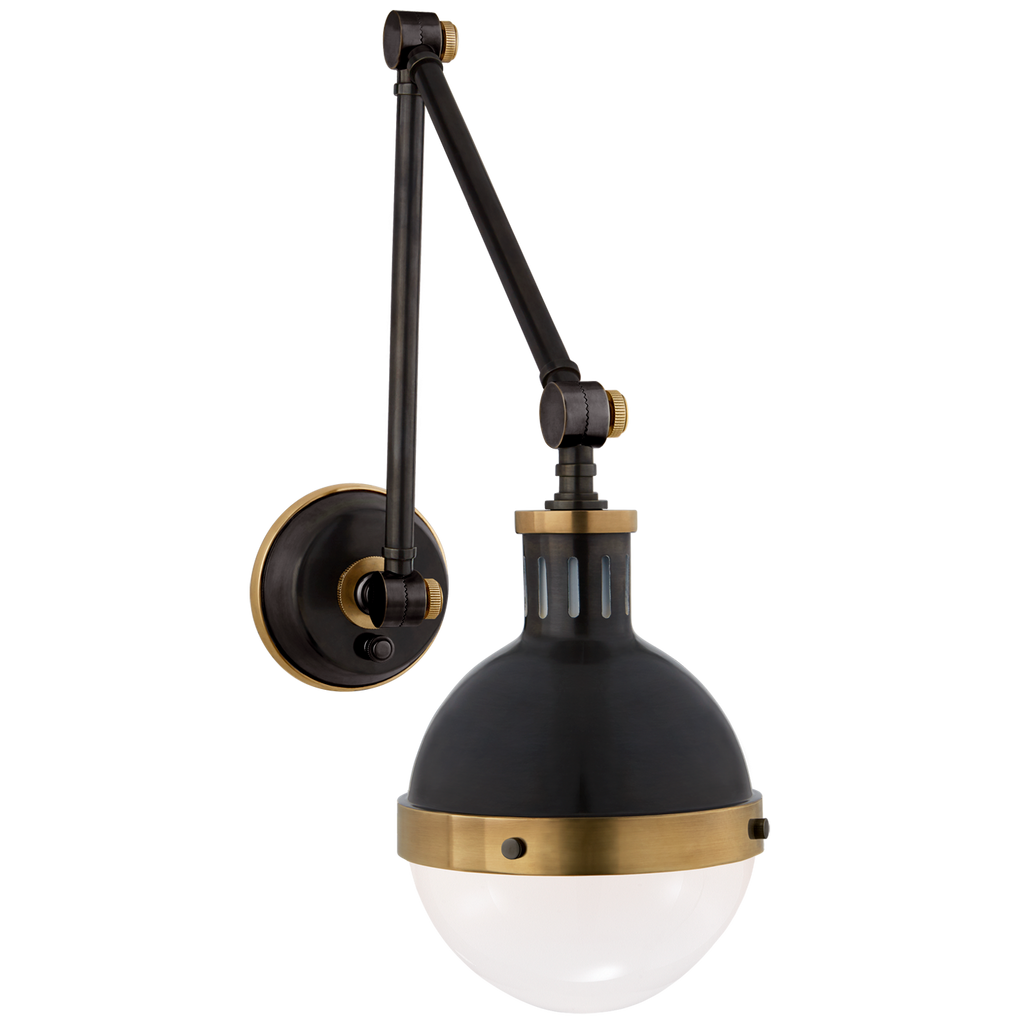 We love how the Hicks Library Light by Visual Comfort has two points of movement with a dimmer on the backplate. A classy, gorgeous lighting to add to your study, hallway, or other area needing extra light   Designer: Thomas O'Brien