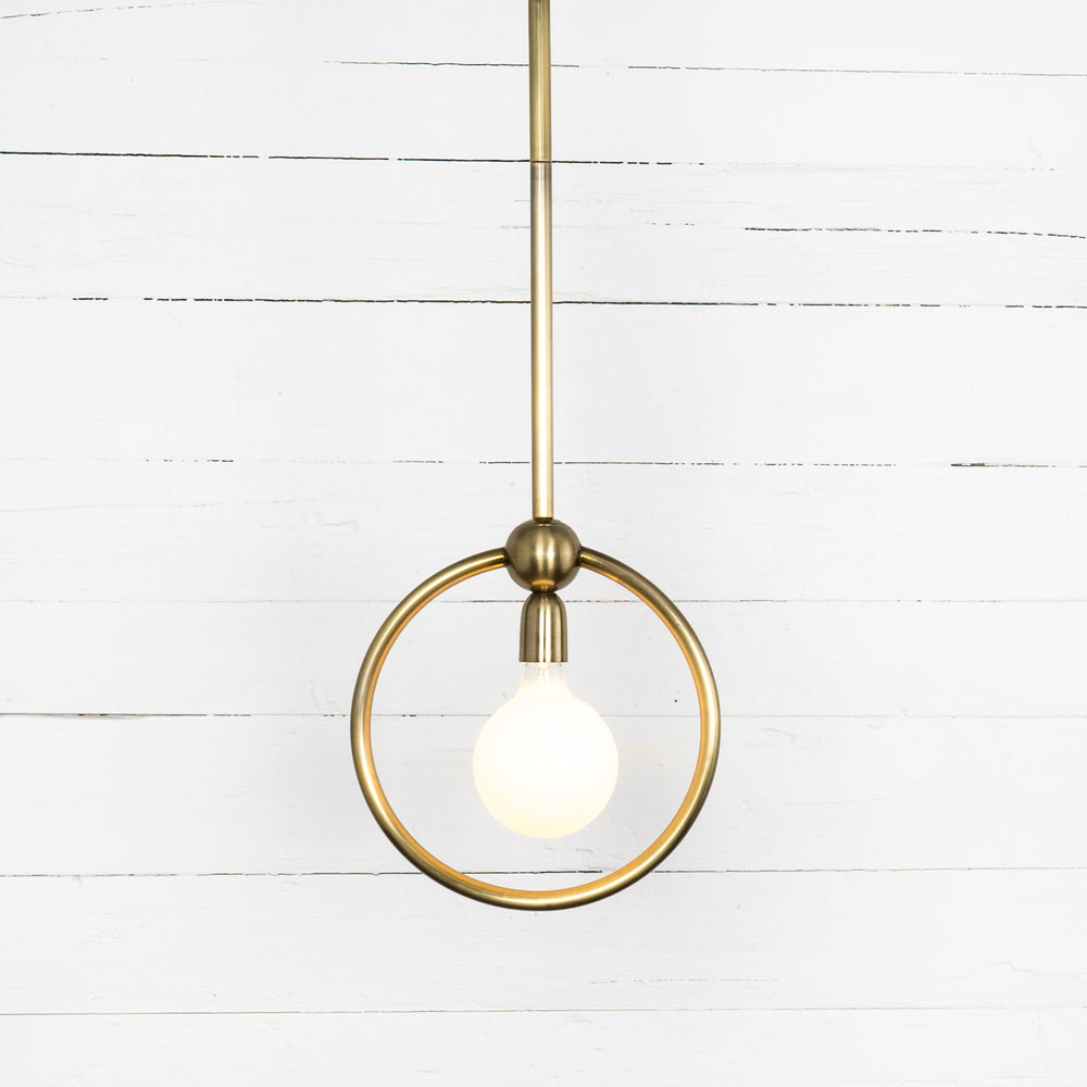 Stainless steel takes on antique brass tones, enhancing light's natural curves. Striking in multiples.