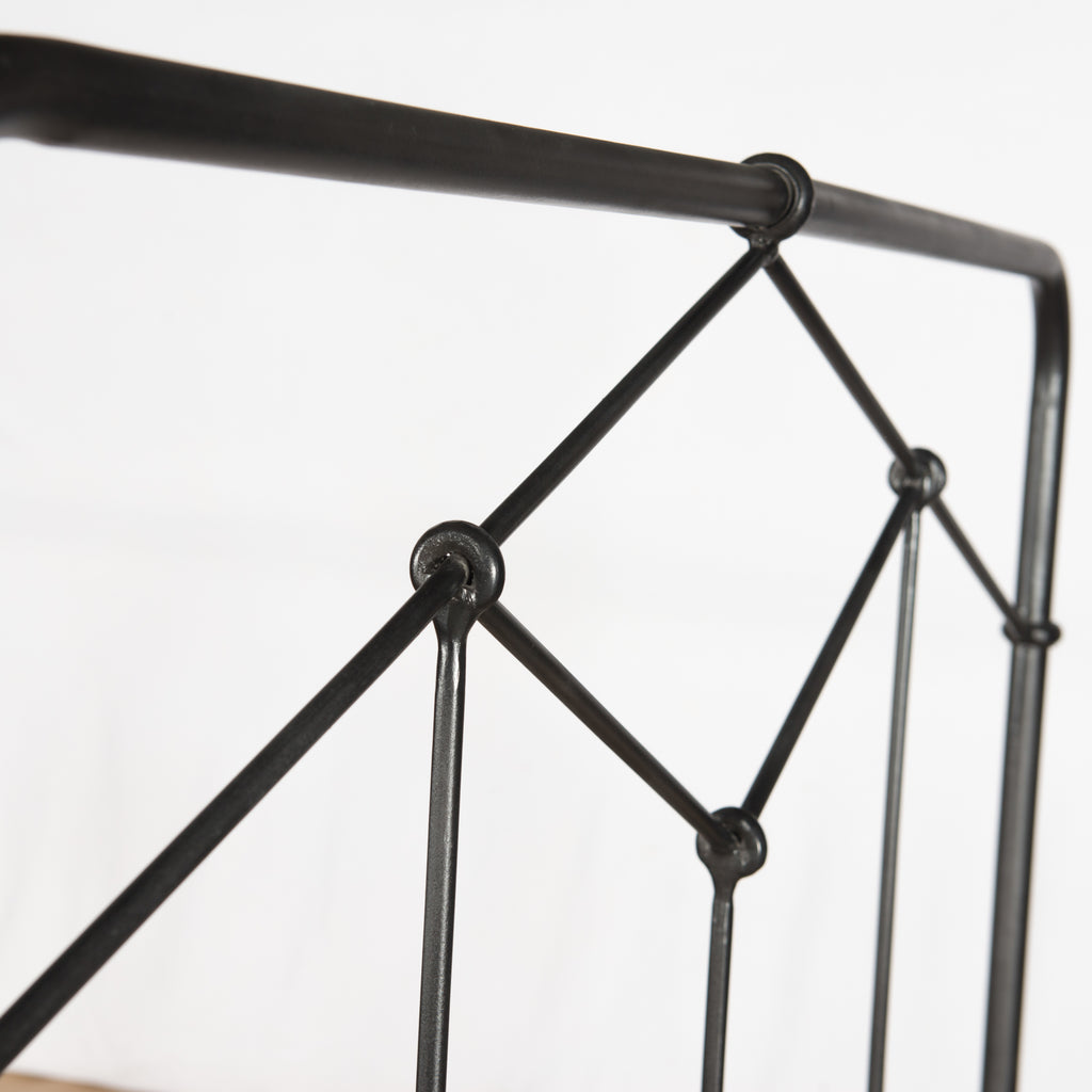 Modern geometric patterns update a design inspired by vintage European hospital beds. Simple iron tubing looks airy and feels substantial. Low-profile box spring recommended.