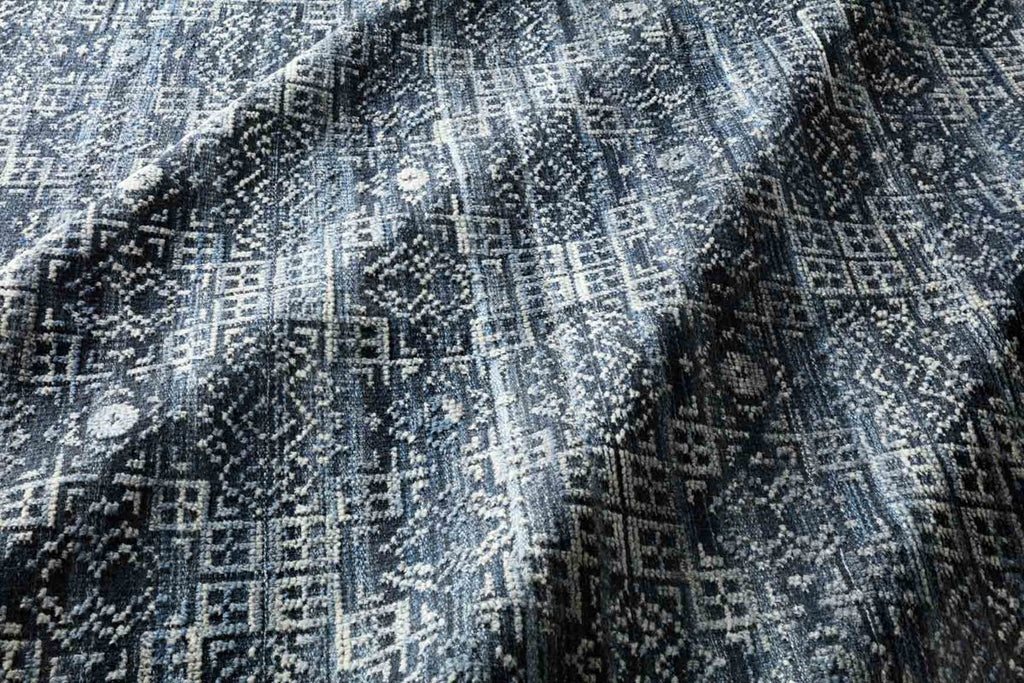 Both timeless and modern, the Idris Collection is meticulously hand-knotted of viscose and wool. The tonal series features an elevated texture, accentuating the pattern in every piece.  Hand-Knotted 70% Viscose | 30% Wool ID-03 Ink