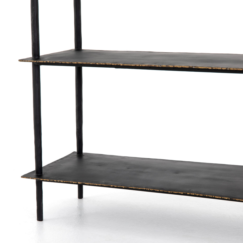 A rubbed black finish brings an industrial sense to open-air console storage. Three wide iron slabs stack, bring a clean, tiered look and ample space for console storage and display.