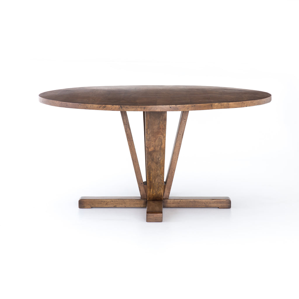 A rounded table of mixed reclaimed woods adopts purposefully-burnished edges, producing a rich, warm patina perfect for the home dining table.