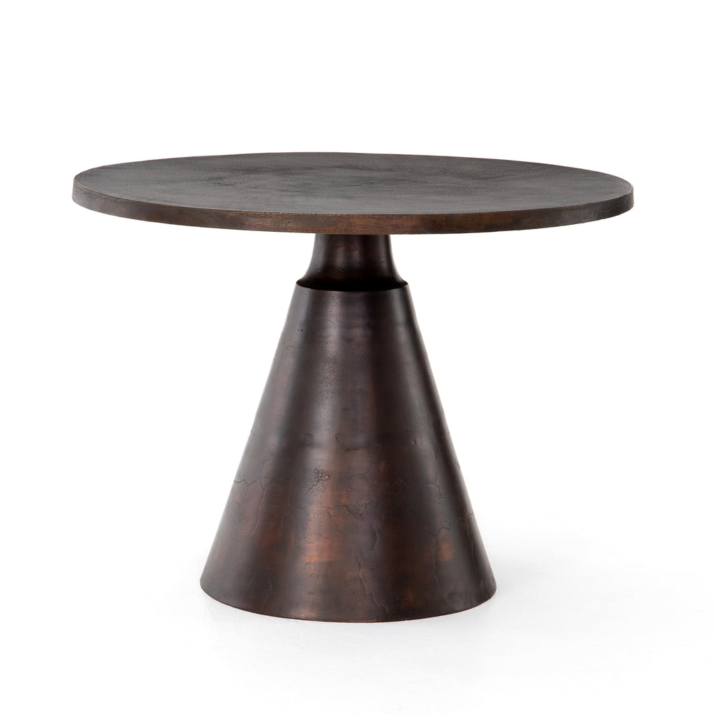 "The Mina Antique Rust Bistro Table is made of solid aluminum, giving both indoors and outdoors a modern-industrial style. Cover or store inside during inclement weather and when not in use.   Size: 40.75""w x 40.75""d x 30""h Materials: Aluminum"