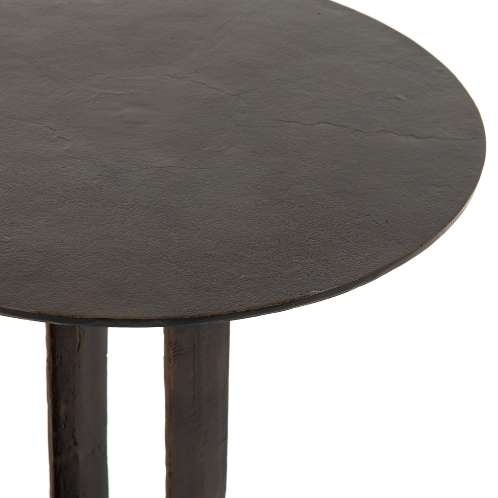 "The Douglas Antique Rust End Table has a rounded shape that creates an open and fun blend of scale and proportion. We love the modern presence it has and the bonus feature of it being safe for outdoor spaces. Cover or store indoors during inclement weather and when not in use.  Size: 17.5""w x 17.5""d x 22.5""h"