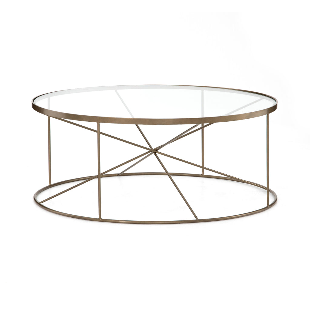Modern geometrics play with antique brass in this softly rounded coffee table. Radiating lines create a sense of simplified, airy space without feeling stark.