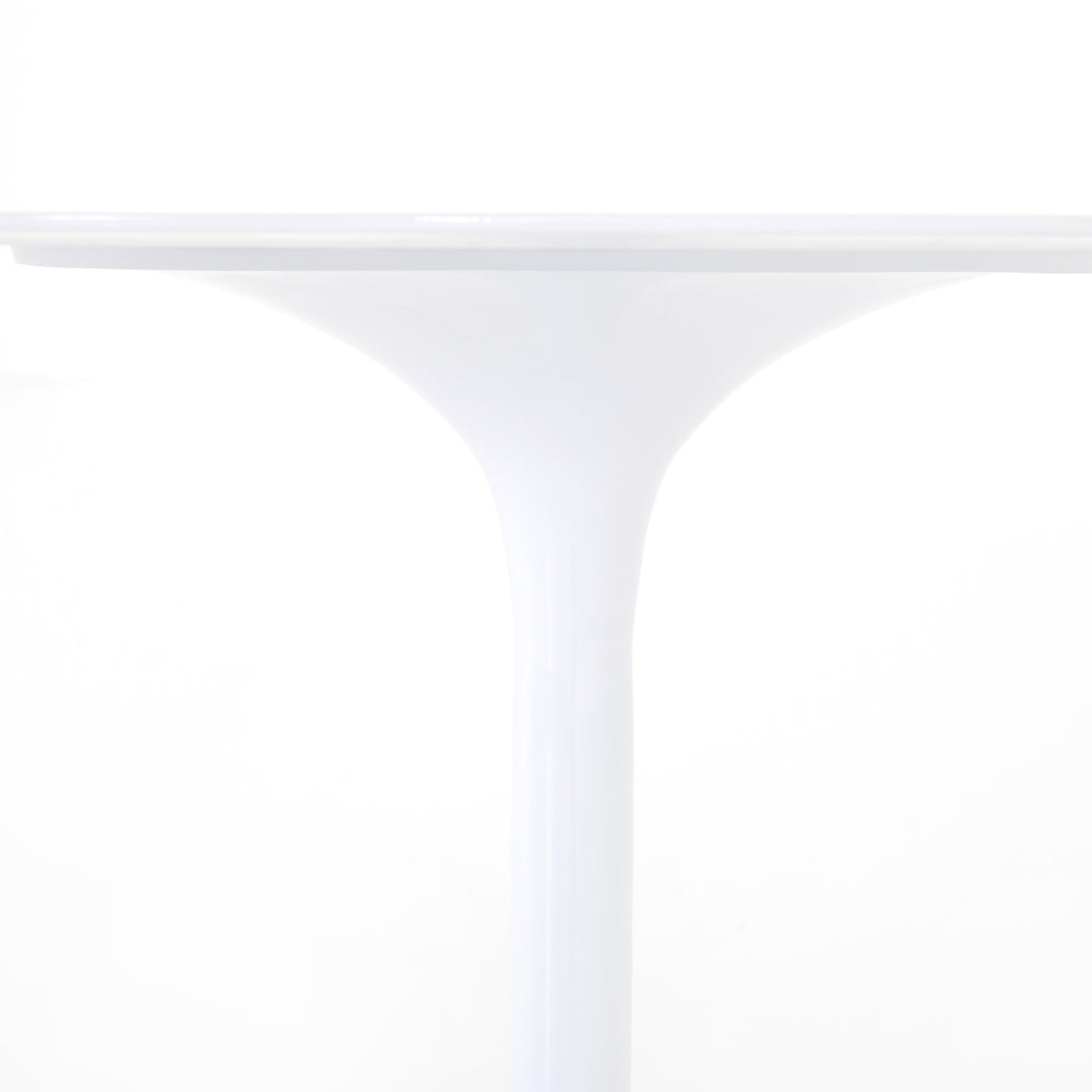 "Classic tulip shaping in white cast-aluminum makes for a modern Simone White Bistro Table. Great indoors or out. Cover or store indoors during inclement weather and when not in use.  Overall Dimensions: 42""w x 42""d x 30""h Materials: Aluminum"