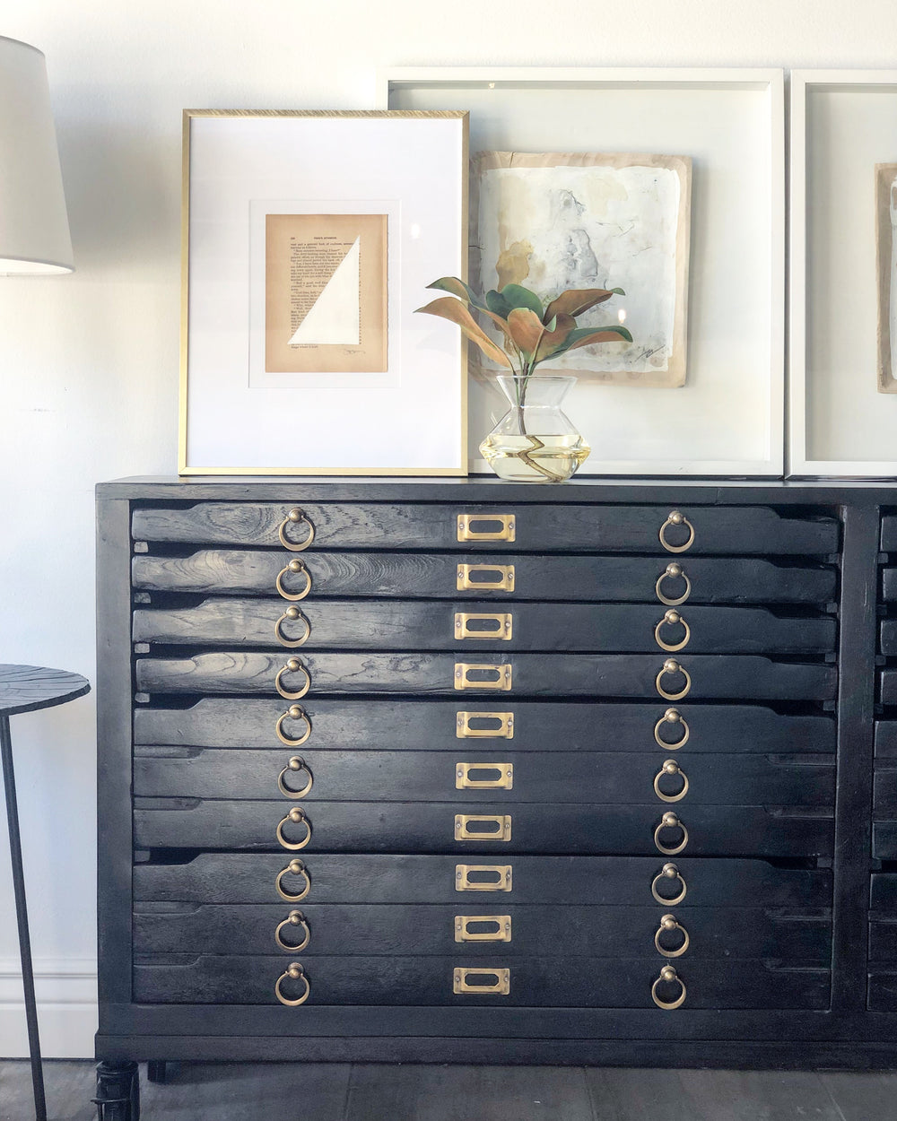"Crafted in vintage black mango wood and with brass hardware the Printmakers Console has been reconfigured to accommodate more space while retaining its classic form. There are 12 drawers for storage. This console is currently in the shop!  Size:  69""w x 13""d x 31""h"