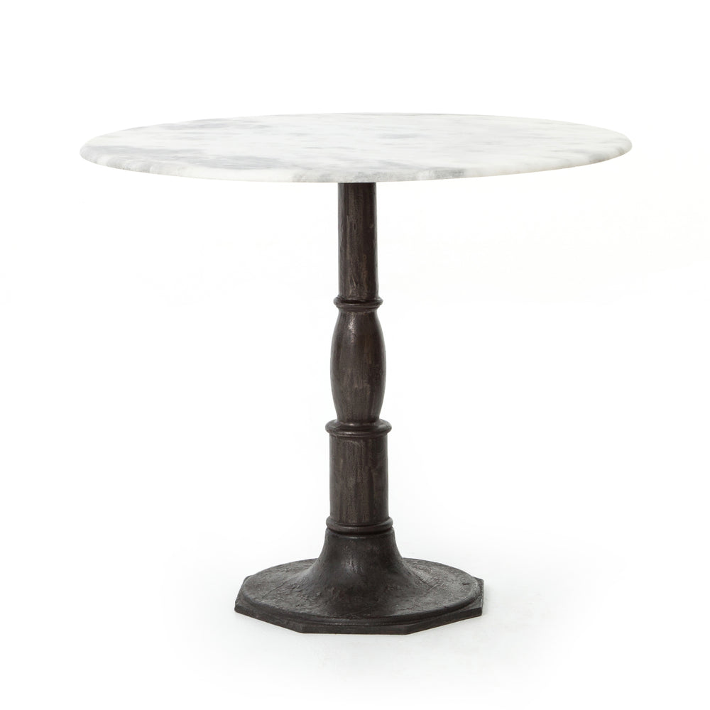 "French-industrial meets bistro table. Detailed, 8-sided cast iron pedestal supports a dramatic white marble top with bull-nosed edge.  Overall Size: 36.00""w x 36.00""d x 31.00""h"