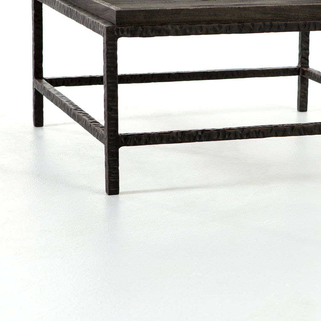 "The Pierson Bunching Table has layers of intrigue. Slim, hammered iron legs support a square-shaped tabletop for a rich yet rough-hewn look that reveals itself more around every angle. Grey mango wood is sandblasted to further an organic, primitive vibe with a modern stance.  Overall Dimensions: 30.00""w x 30.00""d x 15.00""h"