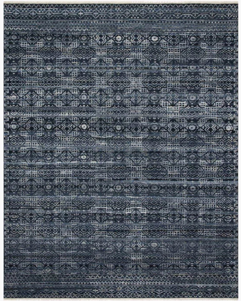 Both timeless and modern, the Idris Ink area rug from Loloi is meticulously hand-knotted in colors of navy, indigo, and grey. The tonal series features an elevated texture, accentuating the pattern in every piece. The Idris Ink Area Rug is hand-knotted with a blend of 70% Viscose and 30% Wool also known as ID-03 Ink.