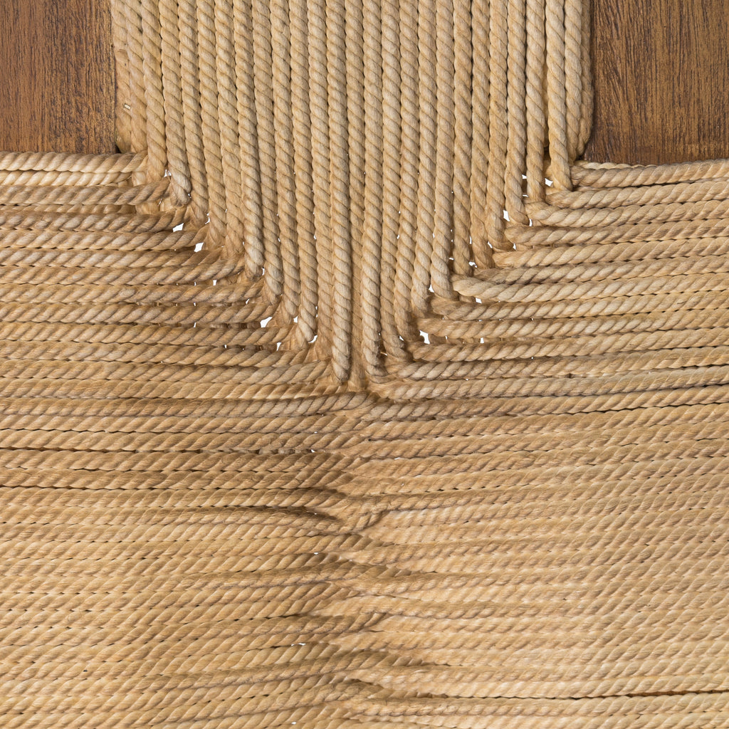Natural in texture and tone. Russet mahogany framing strikes a low-profile pose as vintage cotton rope weaves for an ultra-organic seat reminiscent of its Indonesian roots.