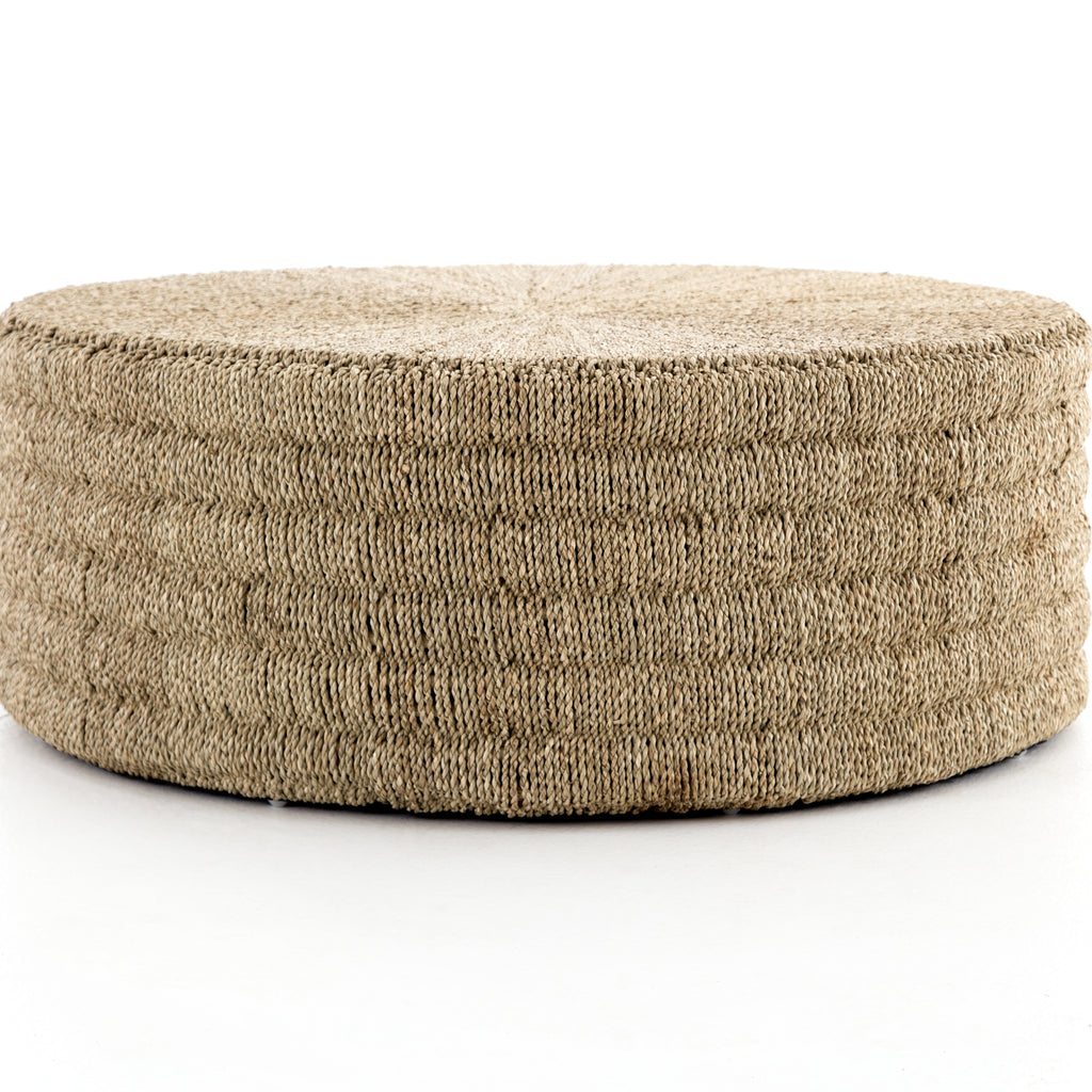 "The Pascal Light Natural Coffee Table is made from pandan rope, hand-woven in Indonesia, reveals its natural texture for a light, neutral look. Soft curves deliver a subtle modern spin to the traditional drum shape.  Size: 42""w x 42""d x 15.5""h"