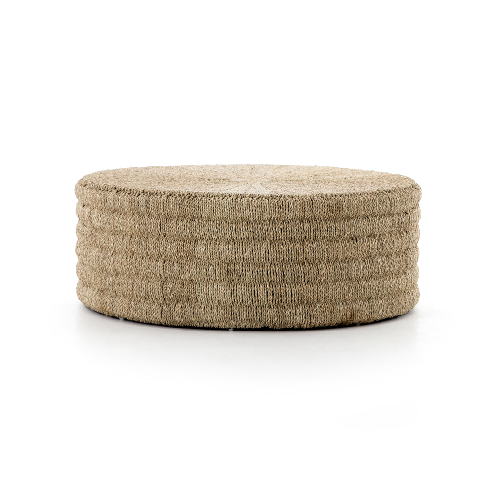 The Pascal Coffee Table - Light Natural is made from pandan rope, hand-woven in Indonesia, reveals its natural texture for a light, neutral look. Soft curves deliver a subtle modern spin to the traditional drum shape.