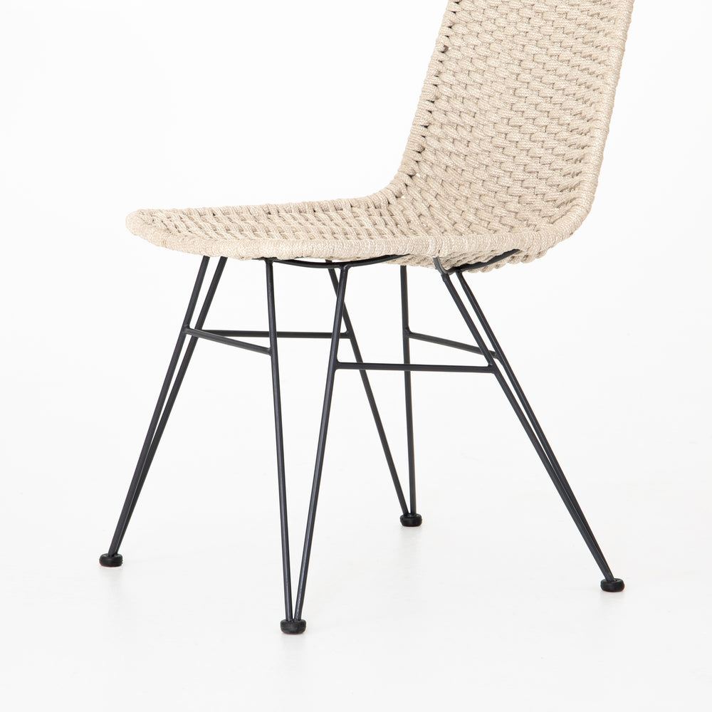 Bring a touch of texture outdoors. Neutral armless seating weaves, with black hairpin legs for a modern touch. Cover or store indoors during inclement weather and when not in use.