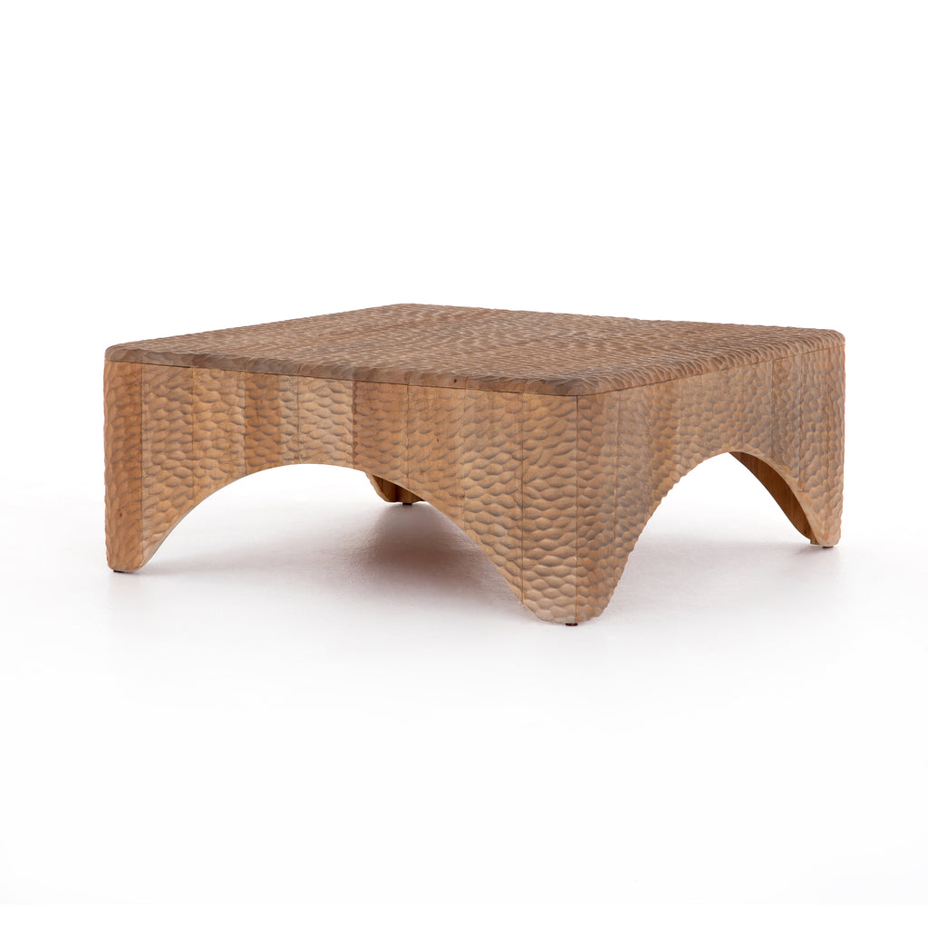 "Inspired by rare 18th-century sake flasks, Atrumed Coffee Table is solid mahogany thoughtfully hand carved, creating a textural, dimple-like look with warm, sun-bleached undertones. Unique variations to be expected, and speak to this piece's handmade nature.  Available Mid September 2020.   Overall Dimensions: 40""w x 40""d x 16""h Materials: Mahogany"