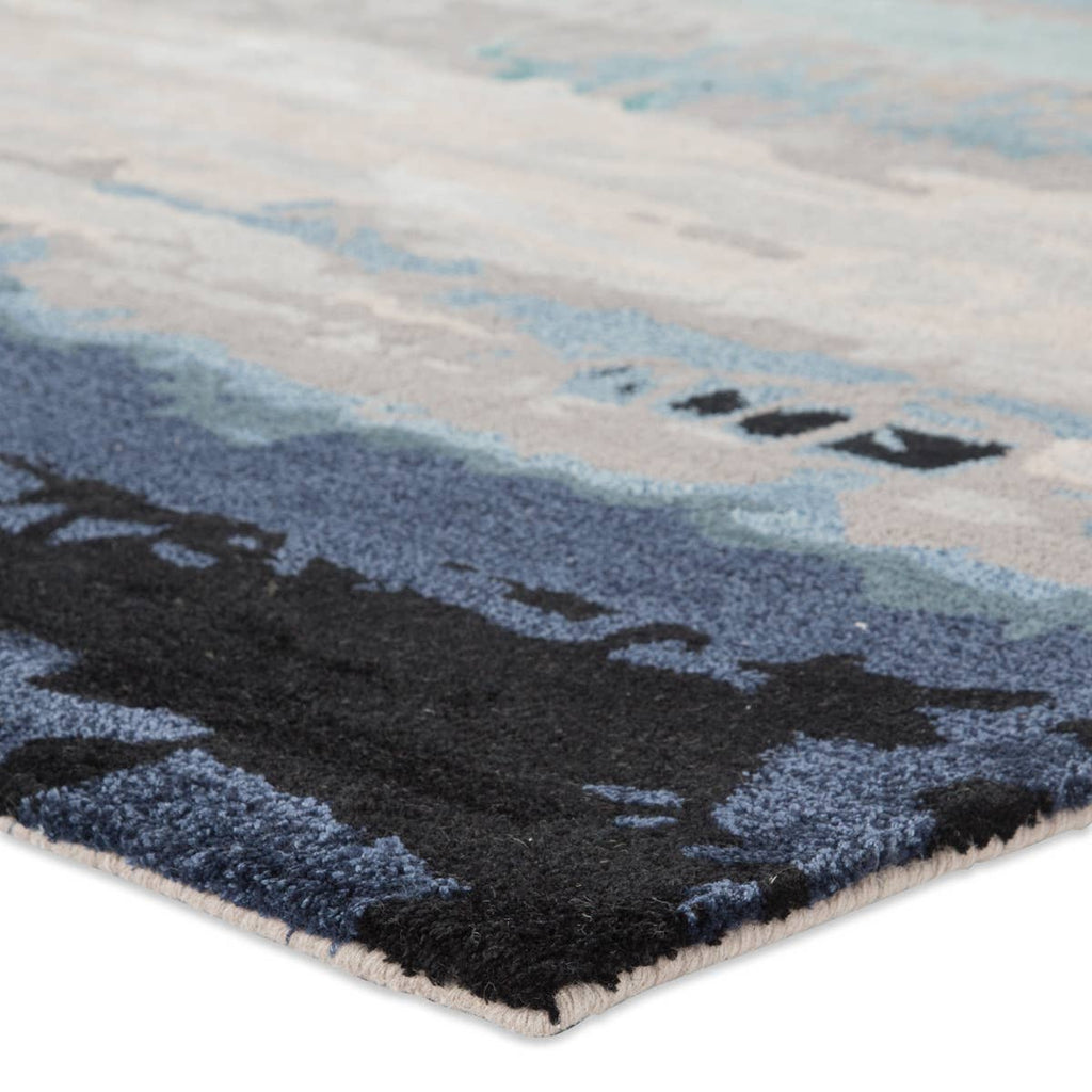 With a whimsical spirit and sophisticated flair, the Genesis collection features an assortment of hand-tufted rugs sure to liven any contemporary home. A cool blue palette and artistic design come together in modern refinement on the Benna area rug. The handsome display of navy, aqua, and beige hues is highlighted by the luxe blend of wool and viscose.