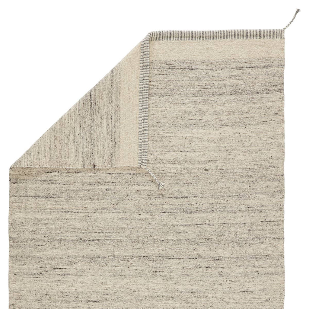 The Nazca Gila Area Rug, or NAZ03, by Jaipur is hand-loomed of texture-rich wool. The Gila area rug boasts a gray and ivory colorway, while the linear border with braided tassel details on each corner give it beautiful, unique touch. This is a perfect rug for a living room, bedroom, or other high-traffic areas