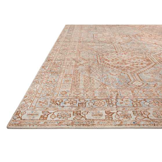 Durable, low pile, and soft underfoot, this rug is inspired by classic vintage and antique rugs. The Jules Chris Loves Julia Tangerine / Mist rug from Loloi features a beautiful vintage pattern and patina. The rug is easy to clean and maintain and perfect for living rooms, dining rooms, hallways, and kitchens!