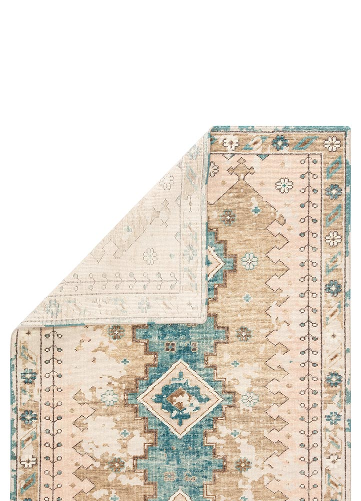The artisan-made Kai collection effortlessly blends the contemporary influence of color with traditionally timeless looks. Exceptionally made and artfully designed, the hand-knotted Pathos area rug infuses homes with vintage allure and an on-trend colorway. Abrashed blue, tan, and blush tones add a chic femme look to the geometric and floral details of this durable wool rug.