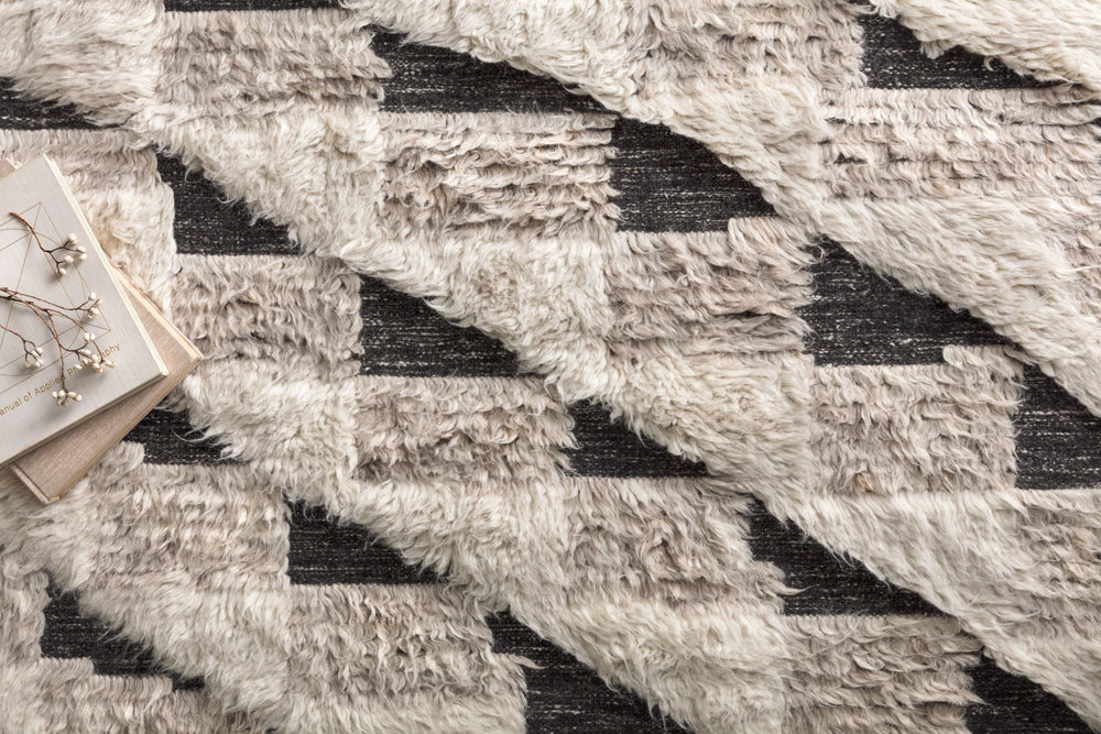 A nod to timeless Moroccan style, the Khalid Collection is hand-knotted in India by skilled artisans. The soft pile features 100% natural, undyed wool, lending slight variations in tones that make each piece its own. Plus, each rug is finished with a thoughtfully designed fringe.  Hand Knotted 100% Wool KF-02