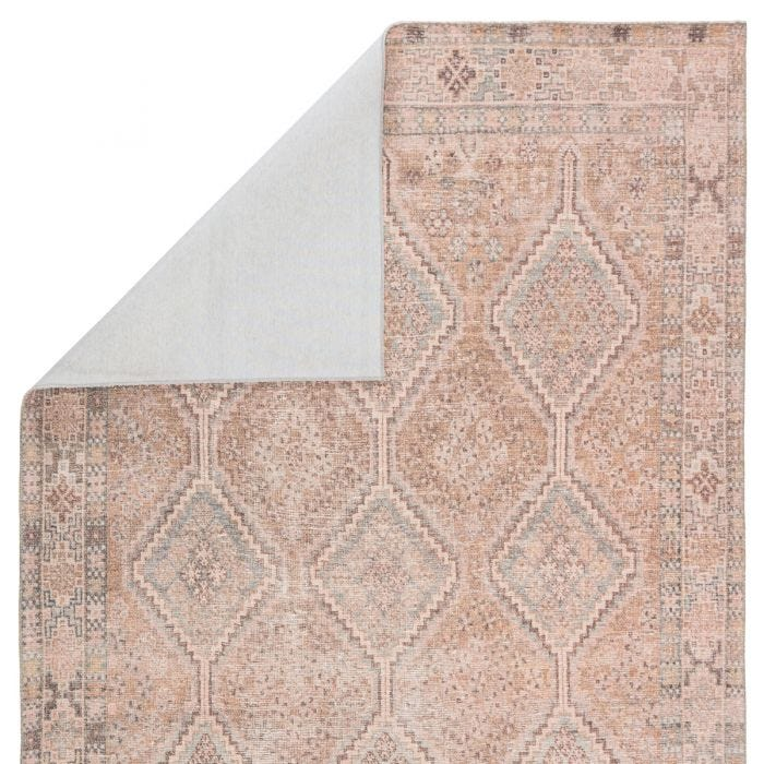 The Kindred collection melds the timelessness of vintage designs with a modern, livable style. The Marquesa area rug boasts an elegantly distressed Turkish diamond pattern in contemporary tones of light pink, blue, gold, and brown. This low-pile rug is made of soft polyester and features a one-of-a-kind antique rug digitally printed design.  Power Loomed  100% Polyester KND01 Kindred Marquesa Rug