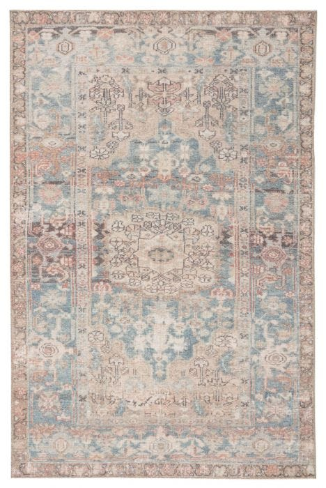 The Kindred collection melds the timelessness of vintage designs with modern, livable style. The Geonna area rug boasts a softly faded center medallion and floral accents in subdued tones of blue, gray, beige, and blush. This low-pile rug is made of soft polyester and features a one-of-a-kind antique rug digitally printed design.