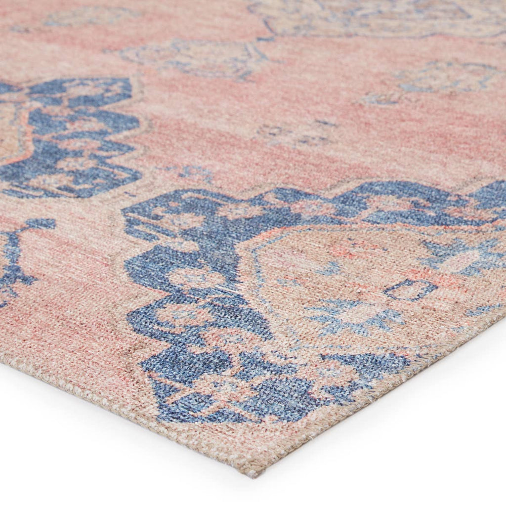 The Jaipur Living Kairos Adalee Area Rug, or KAR01, features dusty pink and blue diamond medallions with subtle distressing for a romantic, elegantly worn look. This power loomed area rug is family and pet friendly and a perfect choice for your living room, dining room, or other high traffic areas.
