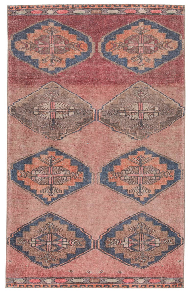 The Jaipur Living Kairos Mirta Area Rug, or KAR07, features a tribal medallion design in vibrant tones of pink, orange, gray, and dark blue, perfectly distressed for a boho-chic touch. This is family and pet friendly and the perfect choice for your living room, dining room, or other high traffic area.