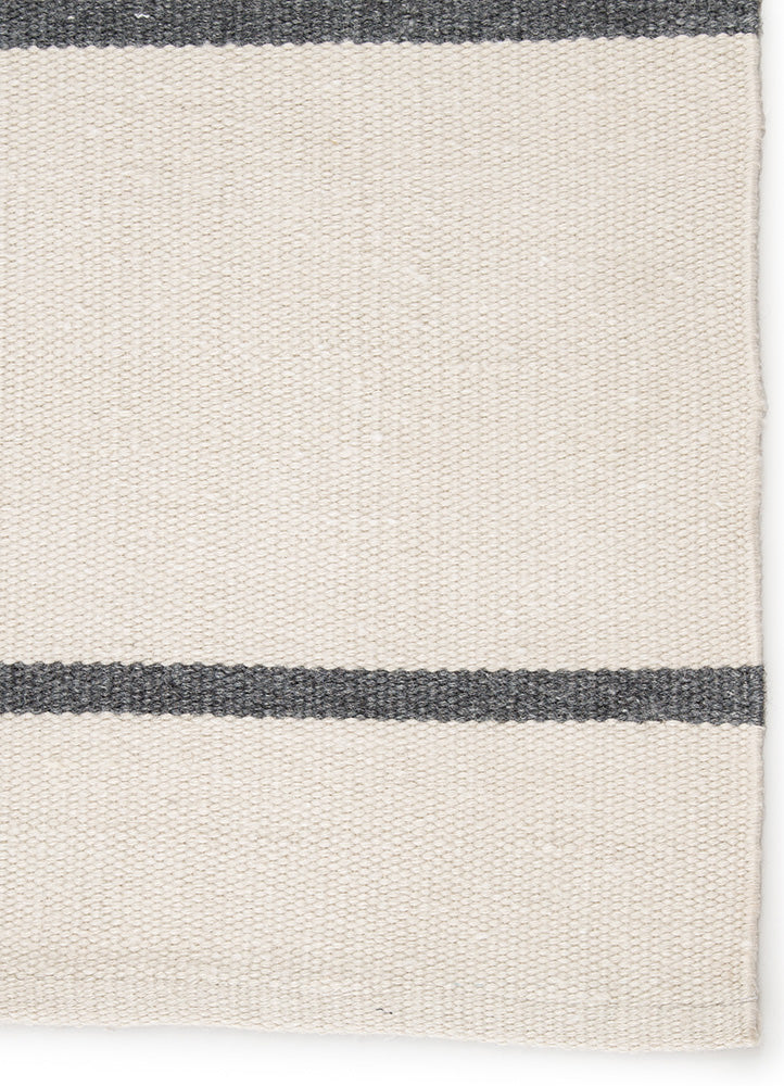 Relaxed and sophisticated in the same moment, the Lanai collection is a chic assortment of nautical designs. The pin stripe Lanai Bone White/Castle Rock area rug infuses both indoor and outdoor spaces with a classic colorway of ivory and gray. Hand woven of eco-friendly P.E.T. yarns, this durable rug is easy to clean and perfect for high-traffic areas.