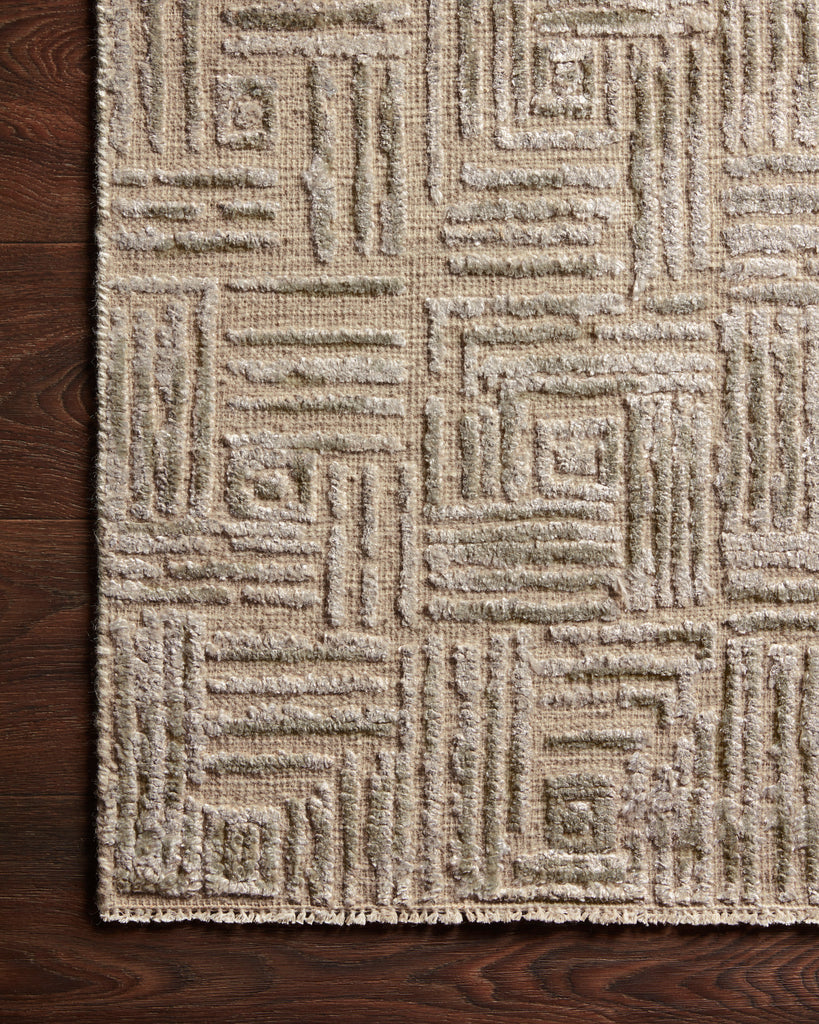 Featuring tone on tone geometric patterns, the Lana Stone Area Rug is hand-knotted of wool, viscose and cotton. Crafted in India, the refined high-low pile is a testament to the dedication of craftsmanship required to create each rug. This would go great in a living room, kitchen, or other medium to high-traffic areas.
