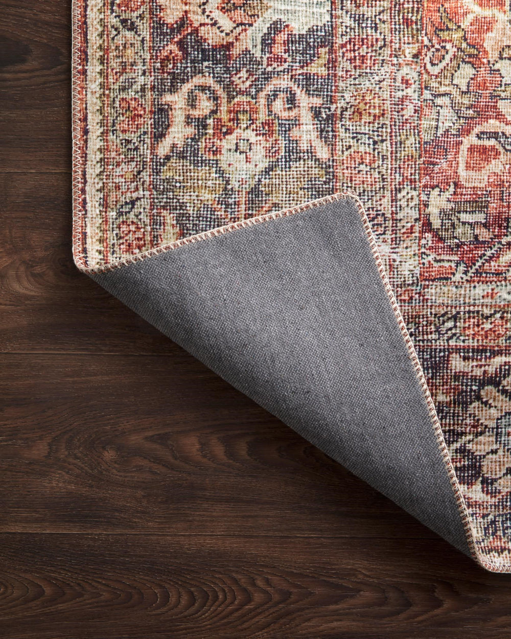 The Layla Collection is traditional and timeless, with a beautiful lived-in design that captures the spirit of an old-world rug. This traditional power-loomed rug is crafted in China of 100% polyester with a classic and sophisticated color palette and subtle patina.  Power Loomed 100% Polyester LAY-02 Spice/Marine