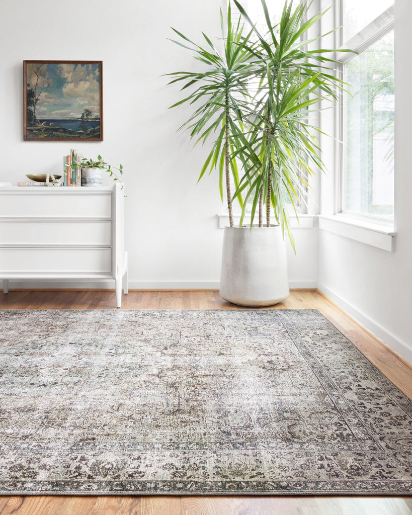 The Layla Collection is traditional and timeless, with a beautiful lived-in design that captures the spirit of an old-world rug. This traditional power-loomed rug is crafted in China of 100% polyester with a classic and sophisticated color palette and subtle patina.  Power Loomed 100% Polyester LAY-06 Taupe/Stone