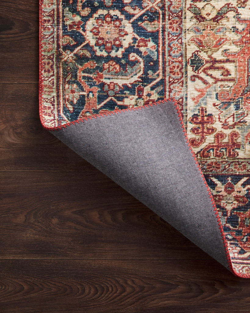 The Layla rug collection from Loloi is traditional and timeless, with a beautiful lived-in design in the spirit of an old-world rug. The Layla Red/Navy area rug is power-loomed of 100% polyester for heavy foot traffic. The rug is a classic with a sophisticated and subtle patina in red, navy, blue, and ivory.